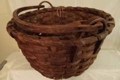 "#153 - Wood Rimmed Antique Handmade Basket - wooden bottom - unique handle rings - 15"" round x 10"" h - some damage"
